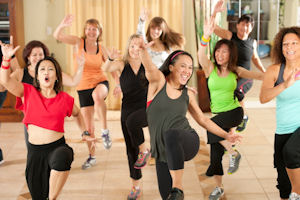 Smiling, active women at Zumba Class